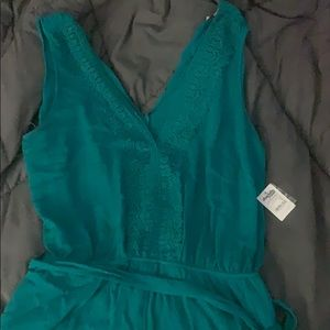 NWT: Emerald romper with vneck and lace trim